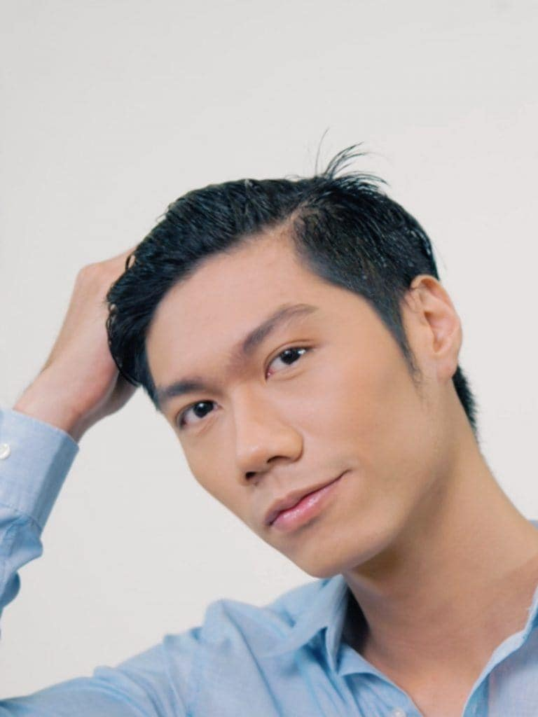 How to style textured bowl cut for men: Asian man hand-combing his freshly washed hair