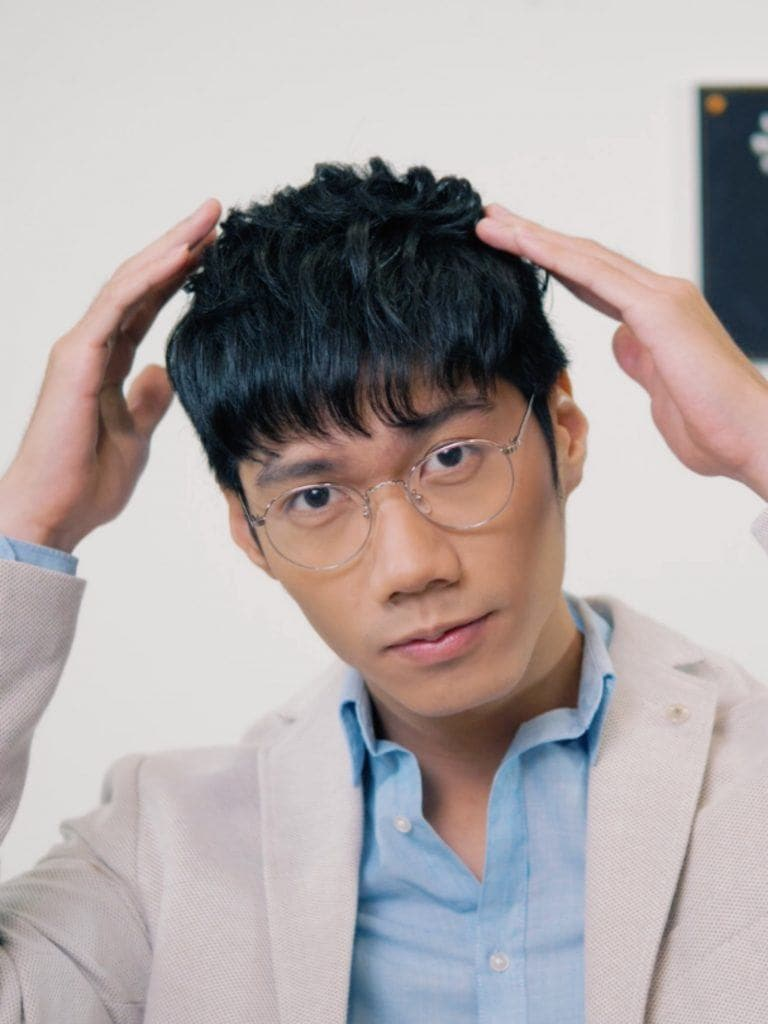 How to style textured bowl cut for men: Asian man posing with his textred bowl cut