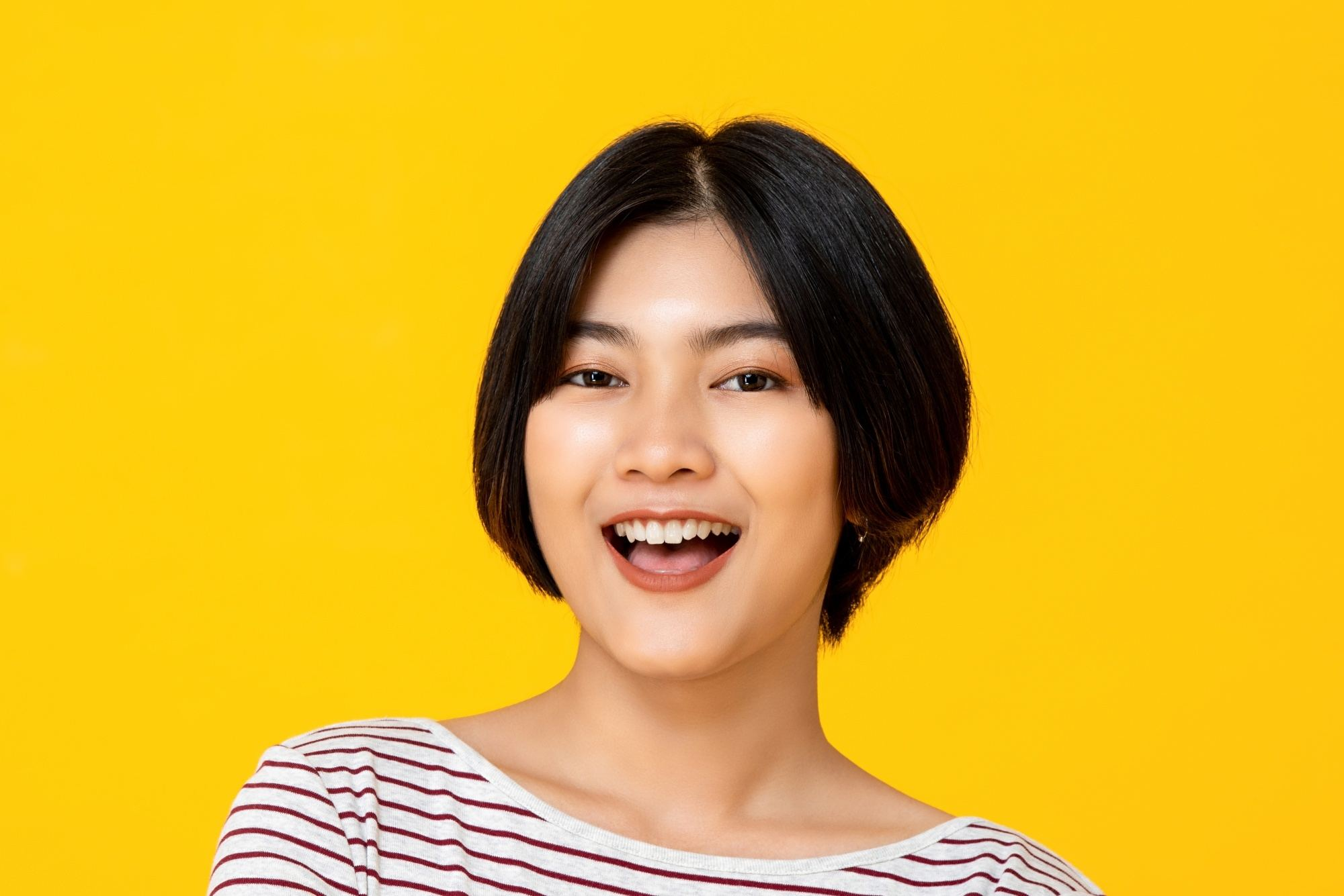 Apple cut hair: a woman smiling with her tapered apple cut