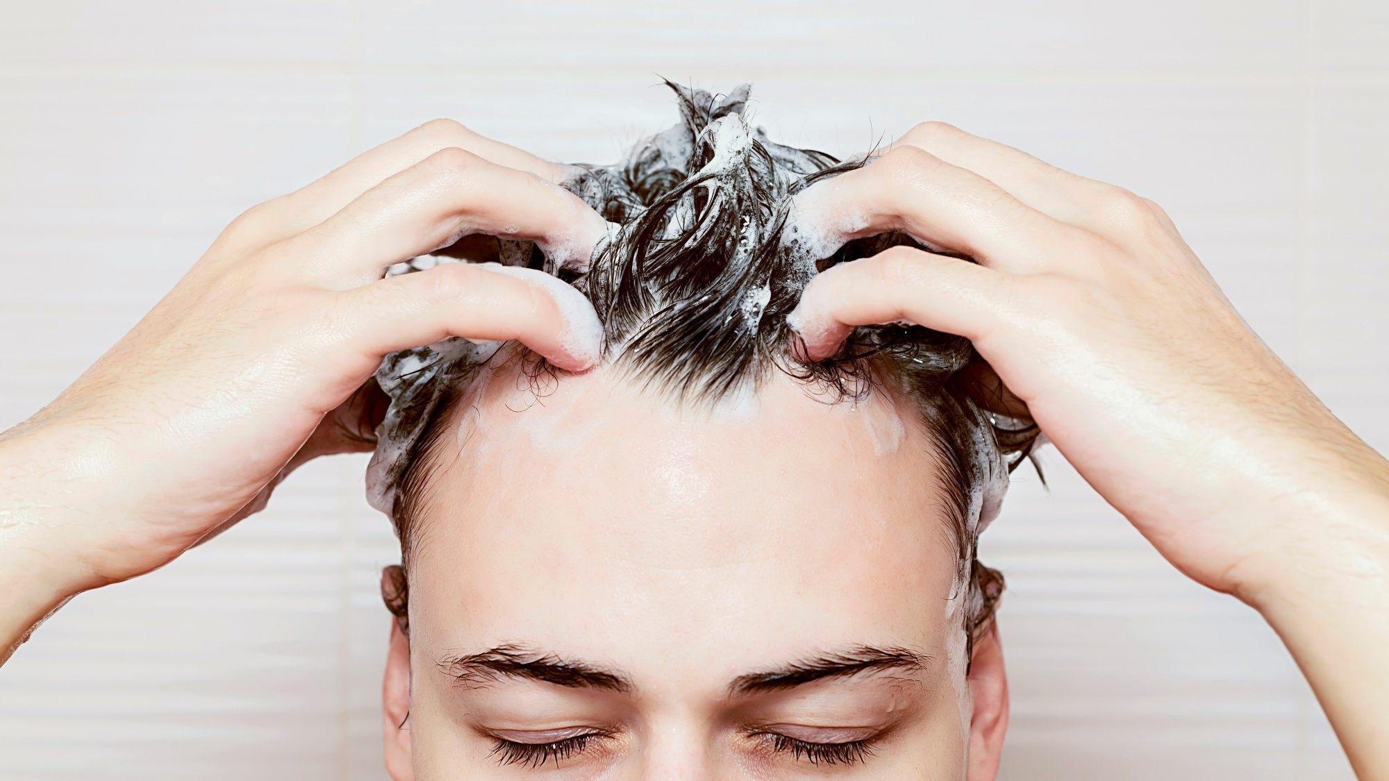 Limp hair men: a man washing his hair
