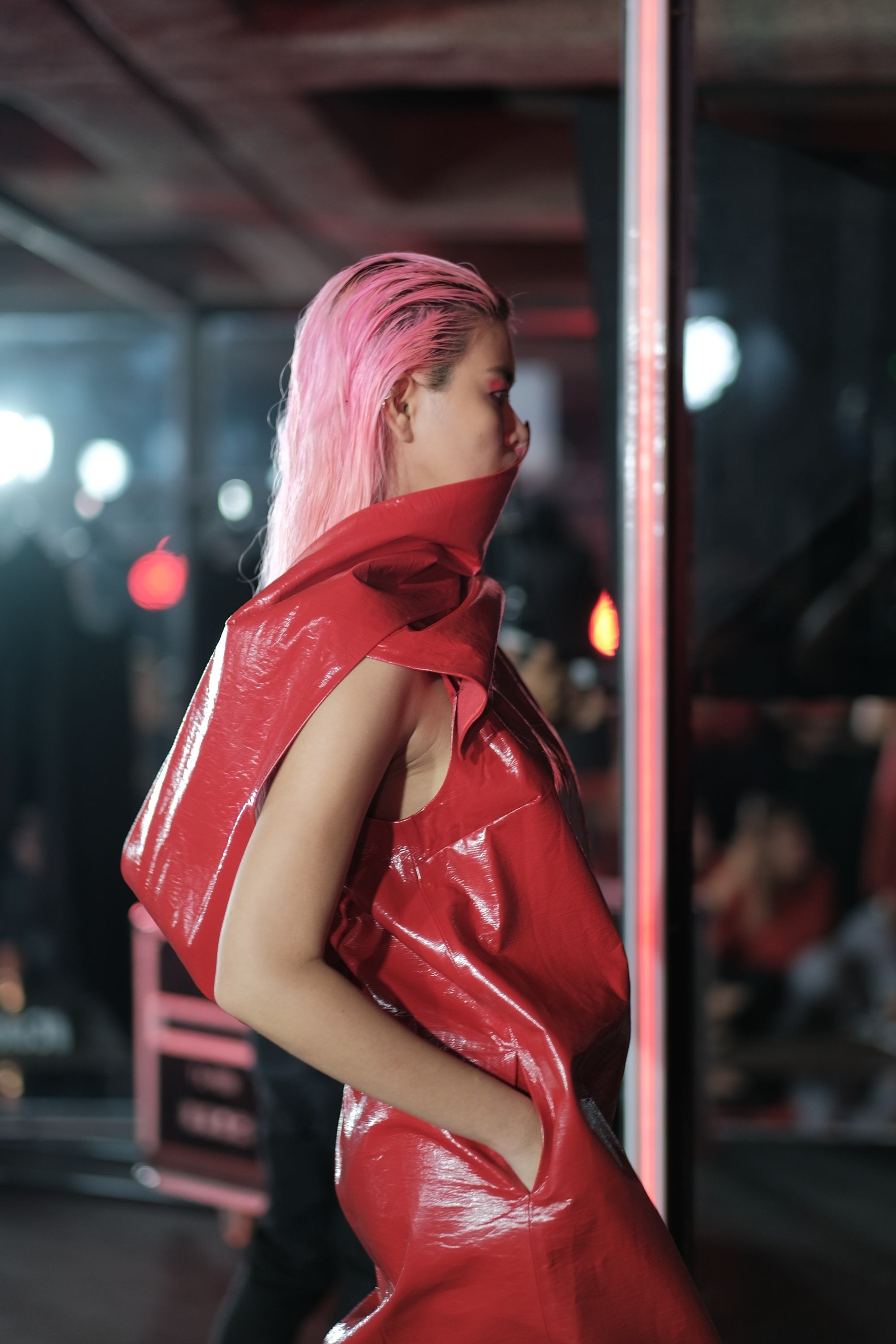 Model with pink hair in a red dress