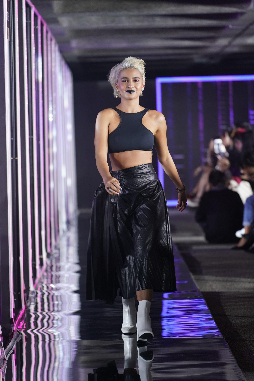 Issa Pressman strutting with her platinum blonde pixie hair