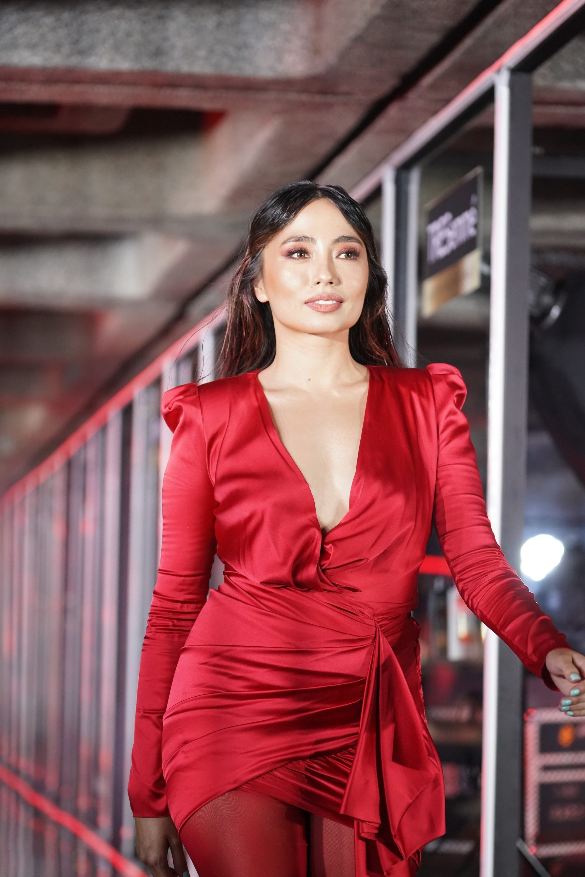 Martine Cajucom in a red ensemble with her red hair highlights
