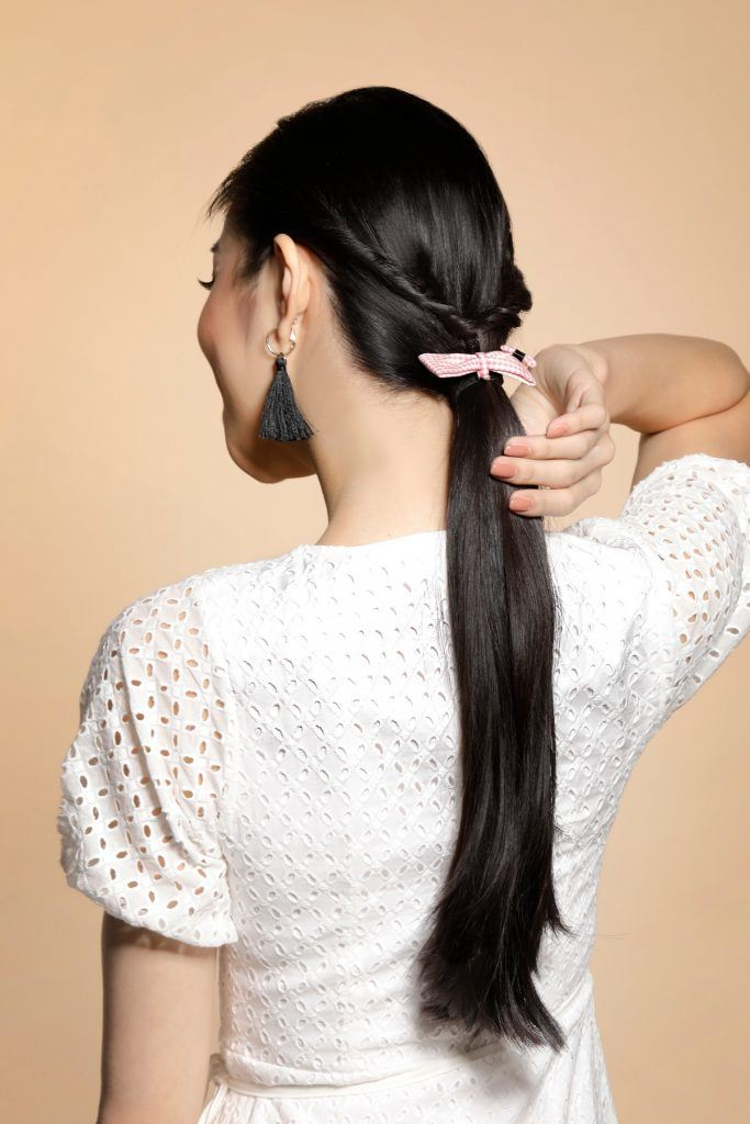 girl wearing a ribbon accessory on her hair to show one of the easy hairstyles for women