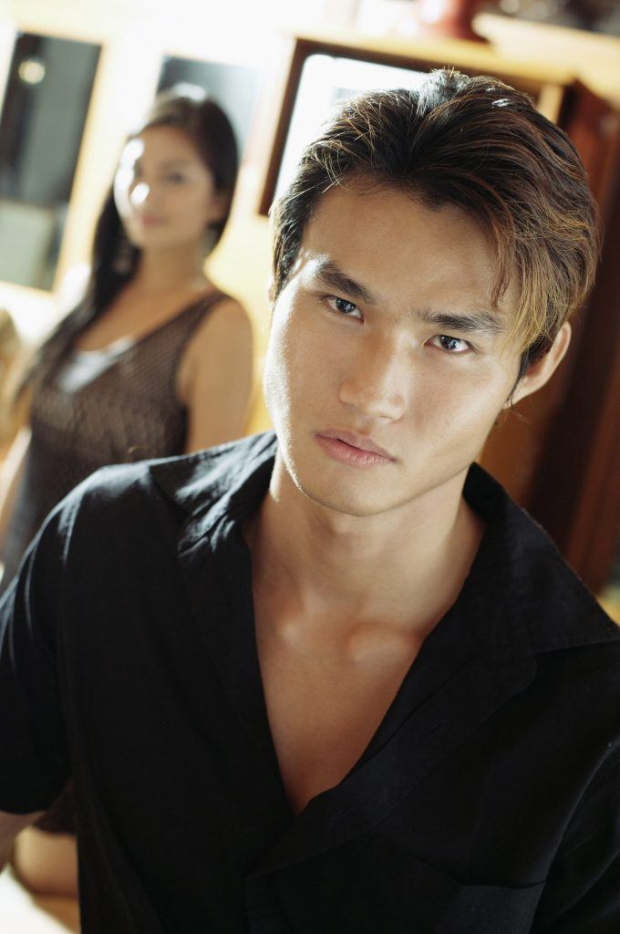 Asian man with black hair and brown hair highlights for men