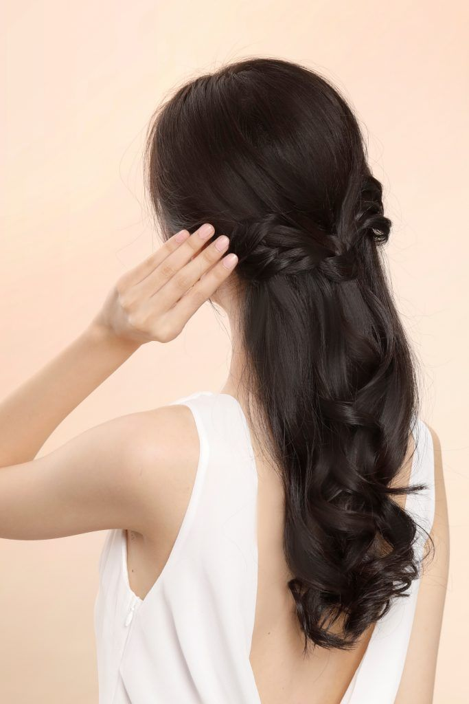 Bridesmaid hairstyles: Asian woman with angel wings half updo