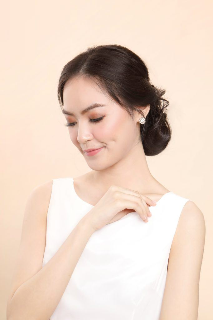 Bridesmaid hairstyles: Asian woman with a chignon hairstyle