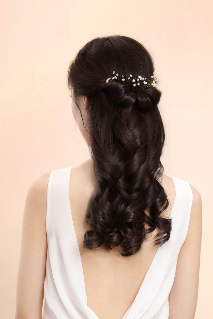 Asian woman with romantic half up bridesmaid hairstyle