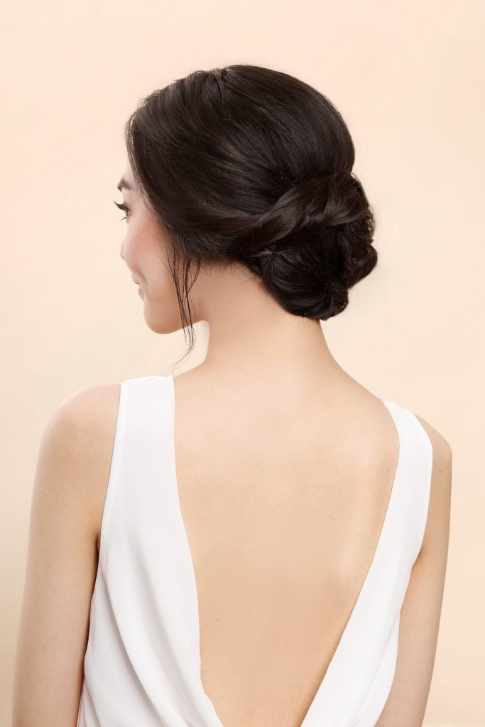 Asian woman with twisted rope bun bridesmaid hairstyle