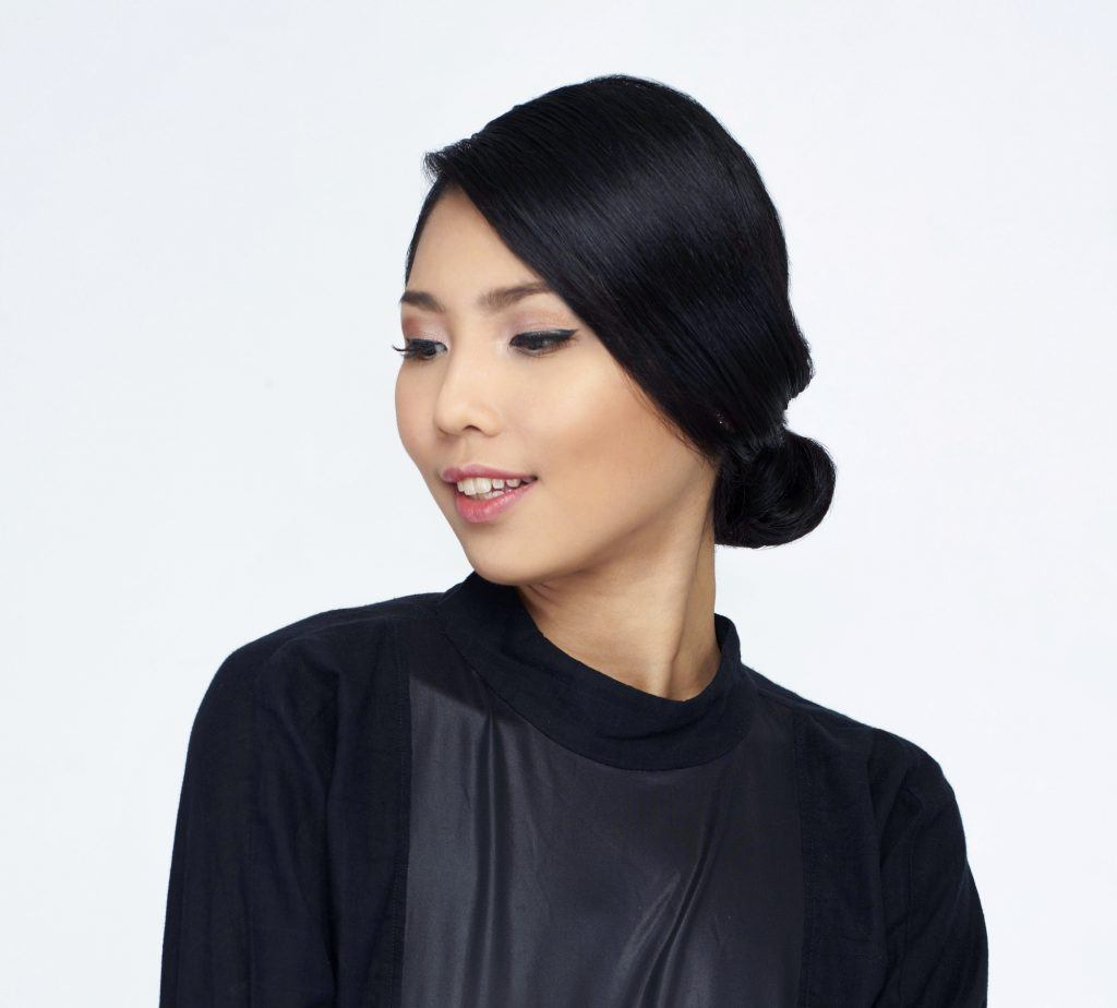 Closeup shot of an Asian woman with chignon updo hairstyle