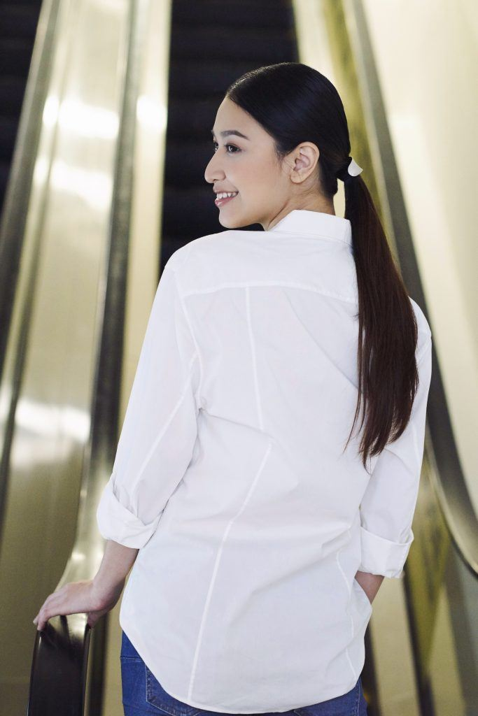 Asian woman with a low pony hairstyle