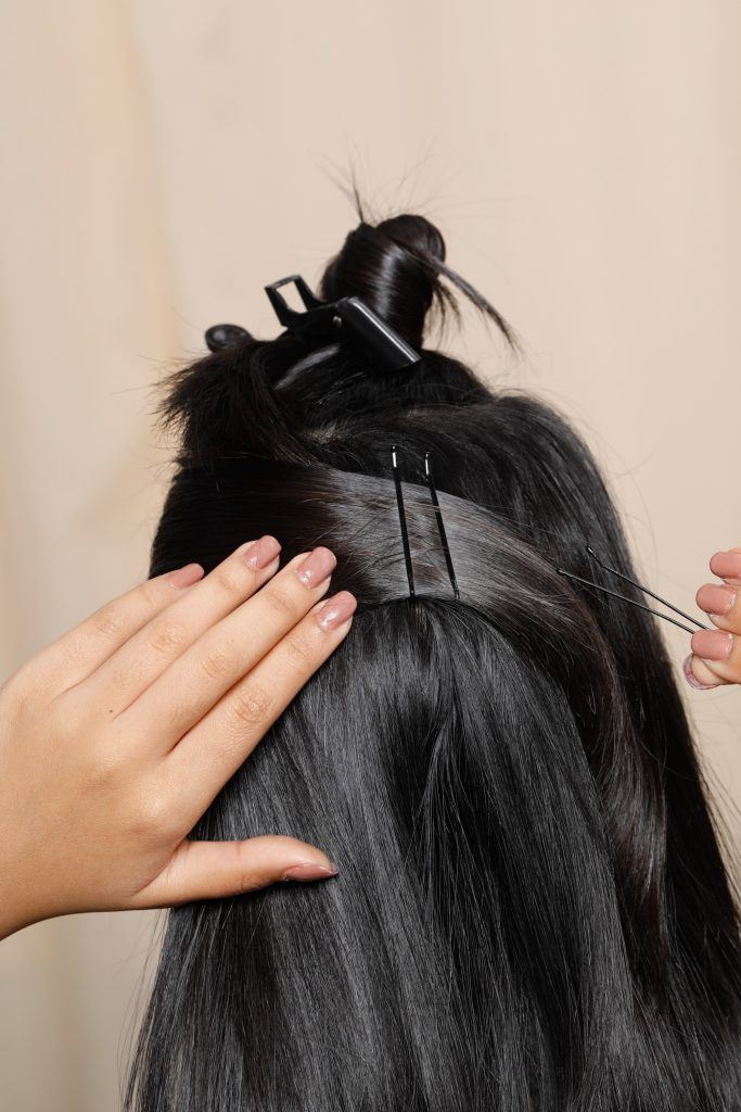 black hair of a girl that has clips and bobby pins