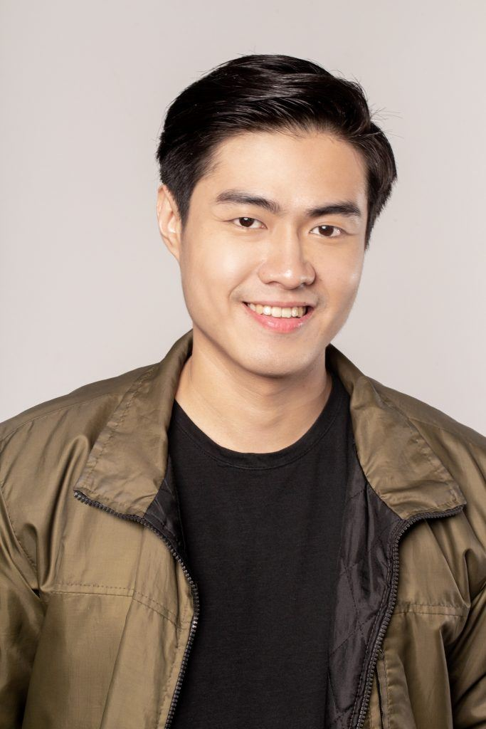 Asian man with a modern quiff hairstyle for round face and wearing a jacket