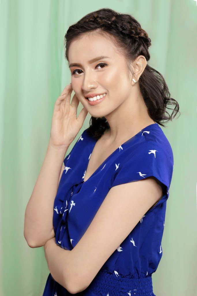 Asian woman with half up Dutch crown braid for short hair wearing a blue dress