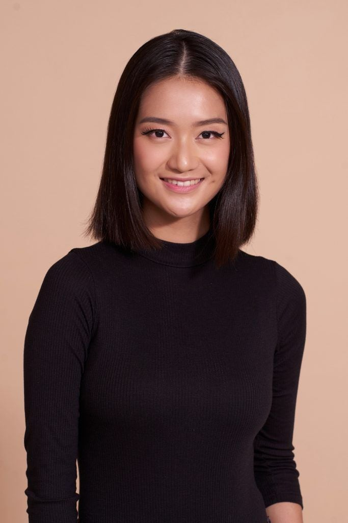 Short haircuts for long faces: Asian woman with a straight blunt lob wearing a black top