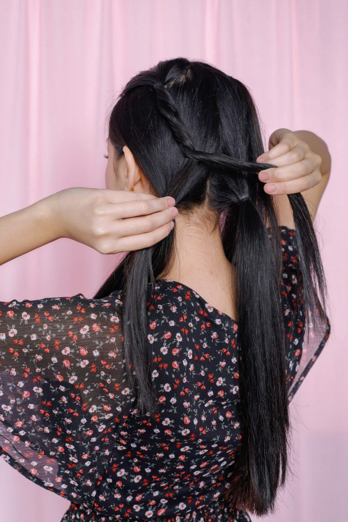 girl is turning her back to show how to do one of the easy braided hairstyles