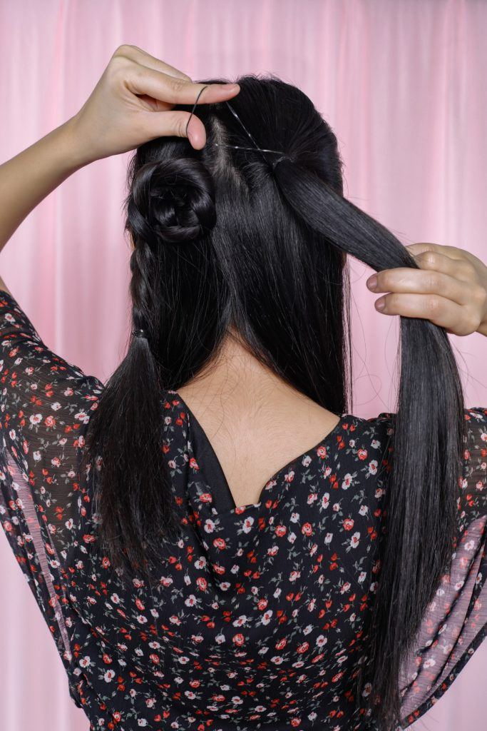 one of the easy braided hairstyles is almost done as shown by the model