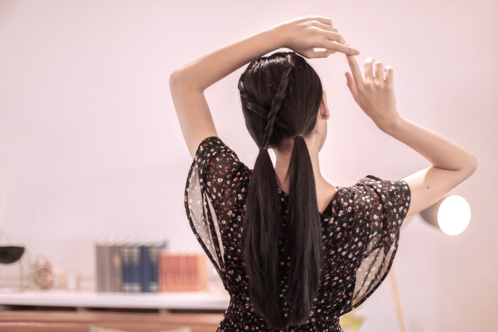girl's back is turned to reveal her hairstyle
