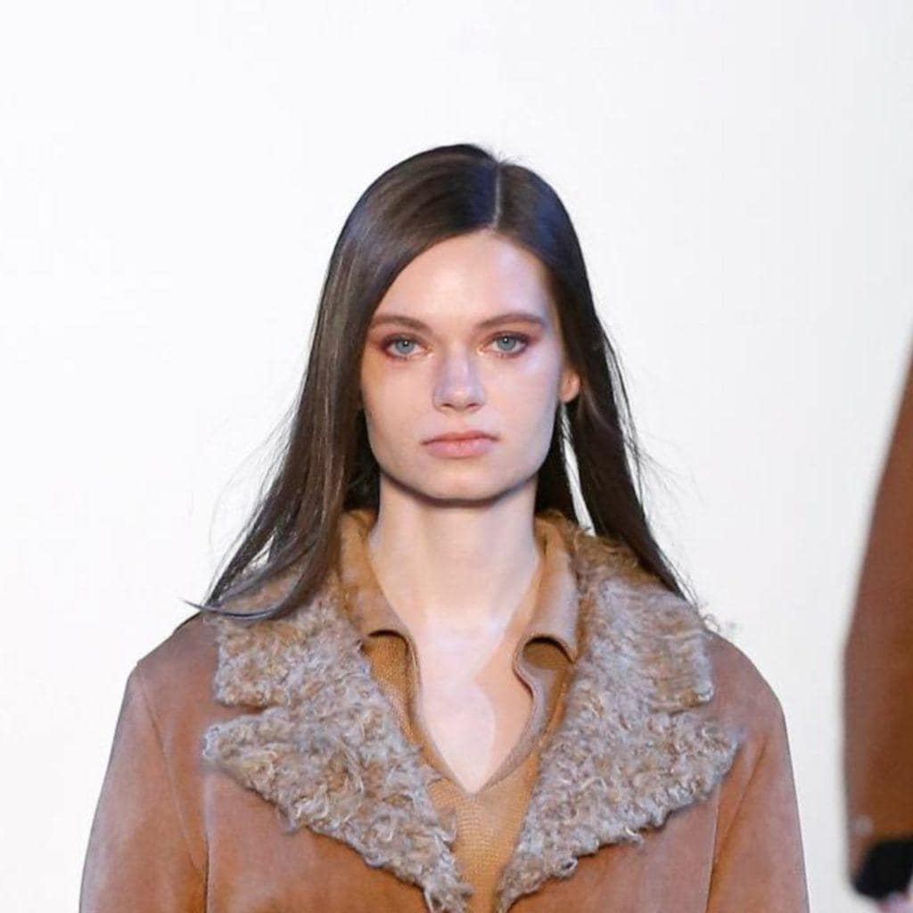 New York Fashion Week 2020: Model is wearing a brown coat with no accessories but has great straight hair