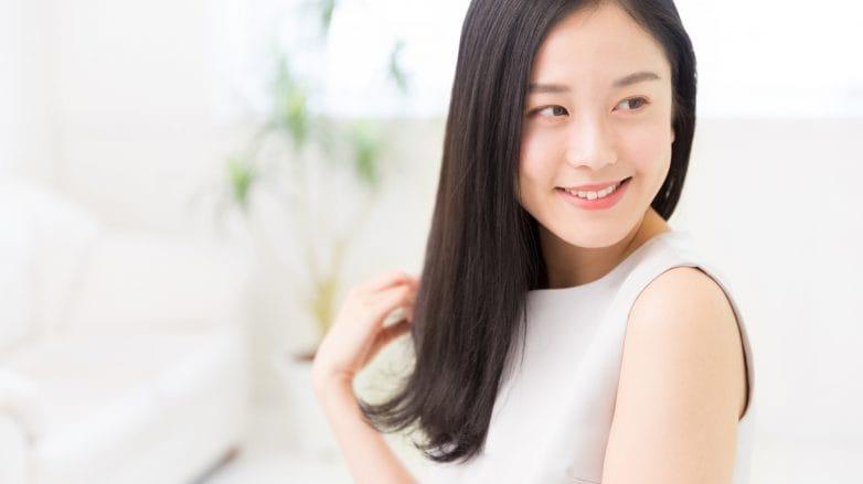 Son Hye Jin Hair Inspiration: Korean woman with long black hair wearing a white sleeveless top