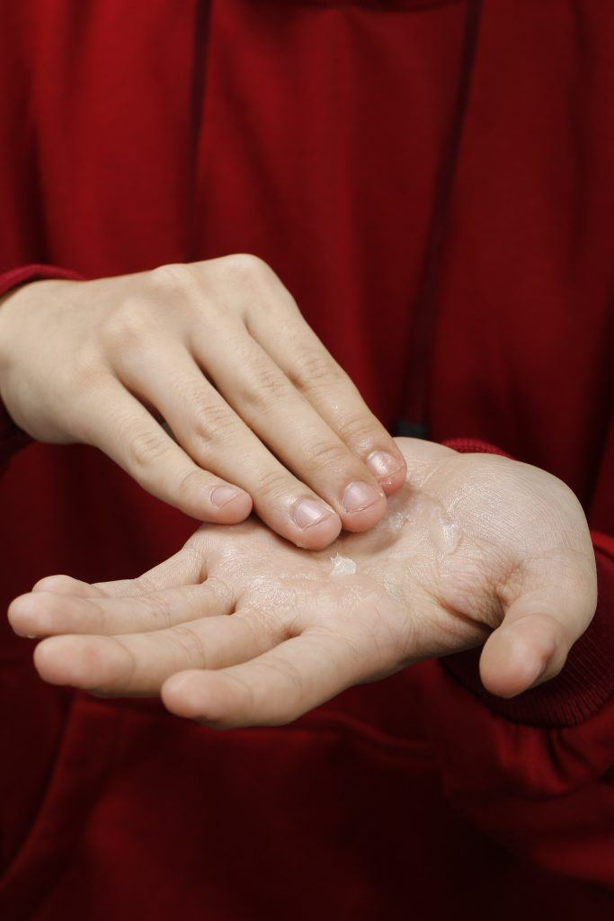 the hands of the model are seen having gel