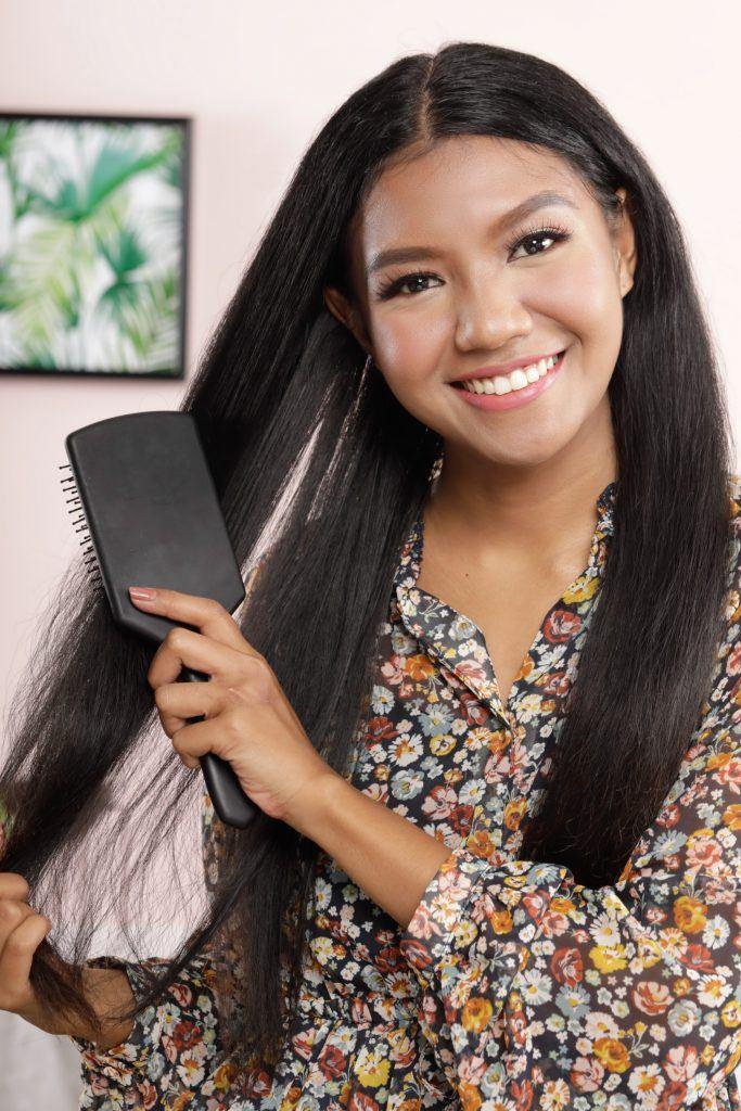 Girl is brushing her hair