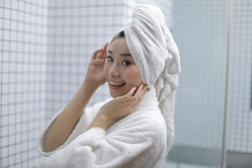 Girl's hair is wrapped in a white towel