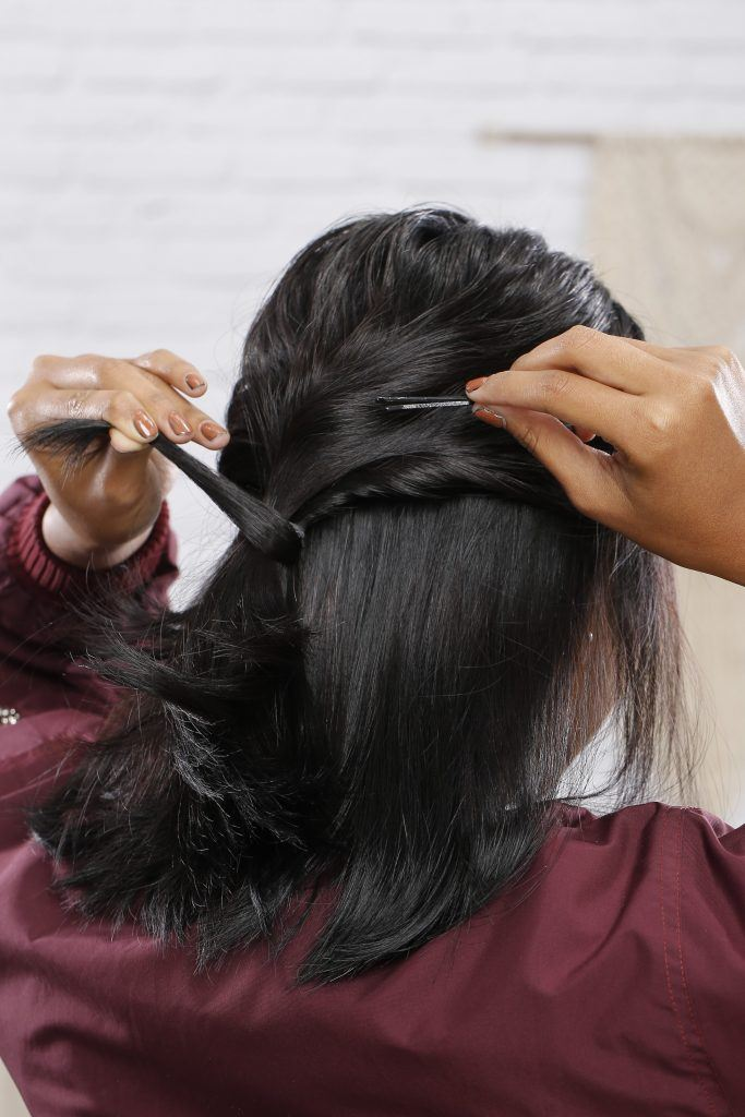 Woman using hair pins