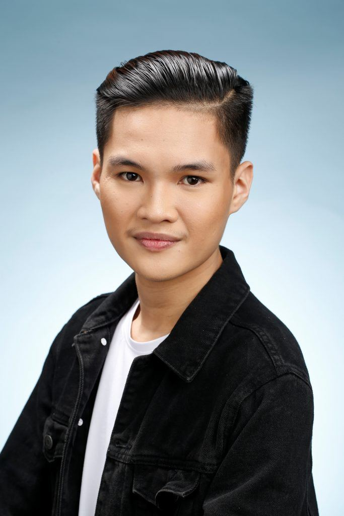 Professional hairstyles for men: Asian man with slicked back hair