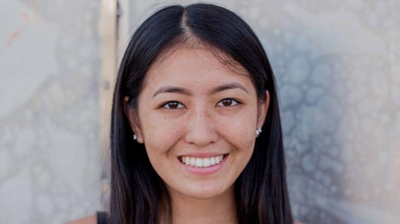 Woman with long dark brown hair smiling