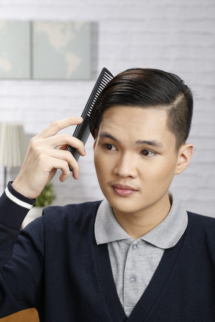 Model is combing his hair