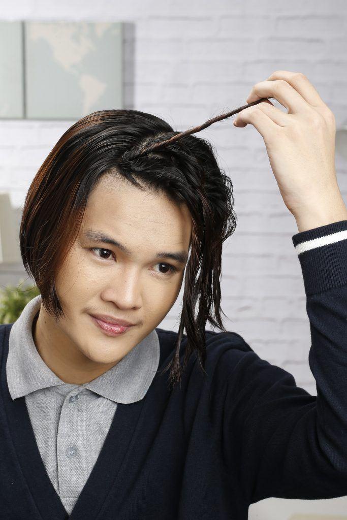 messy hair tutorial for men: still twisting his hair