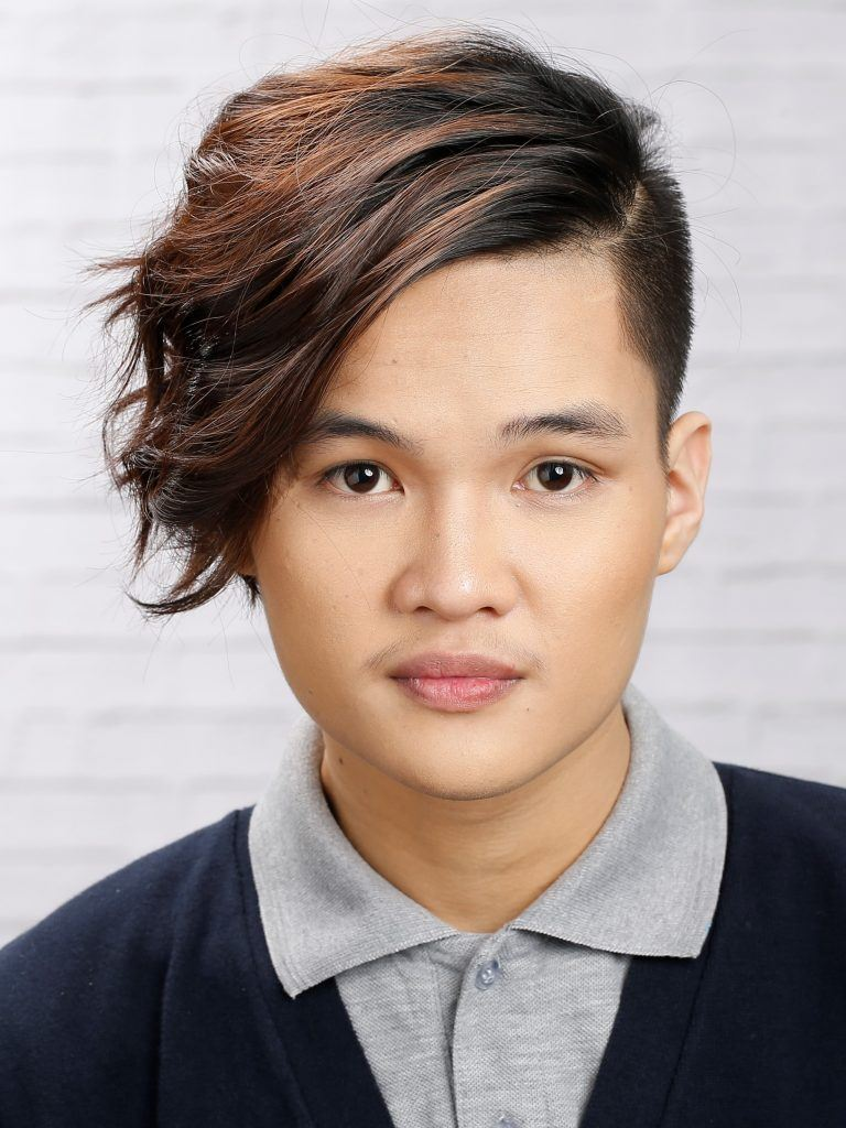 Asian man with messy hairstyle