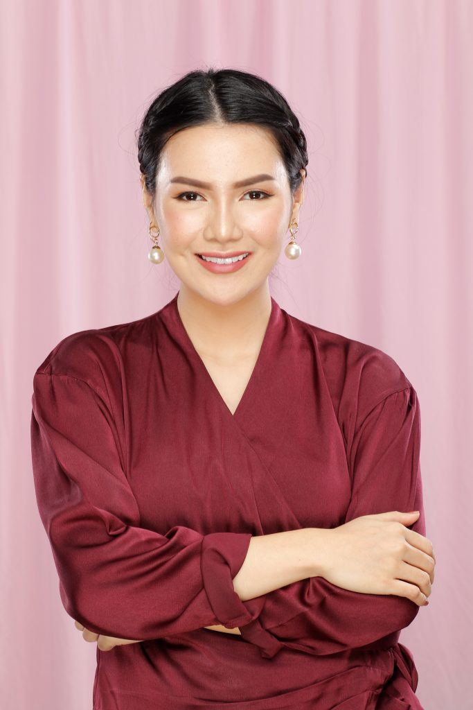 Asian woman with an updo wearing a red blouse