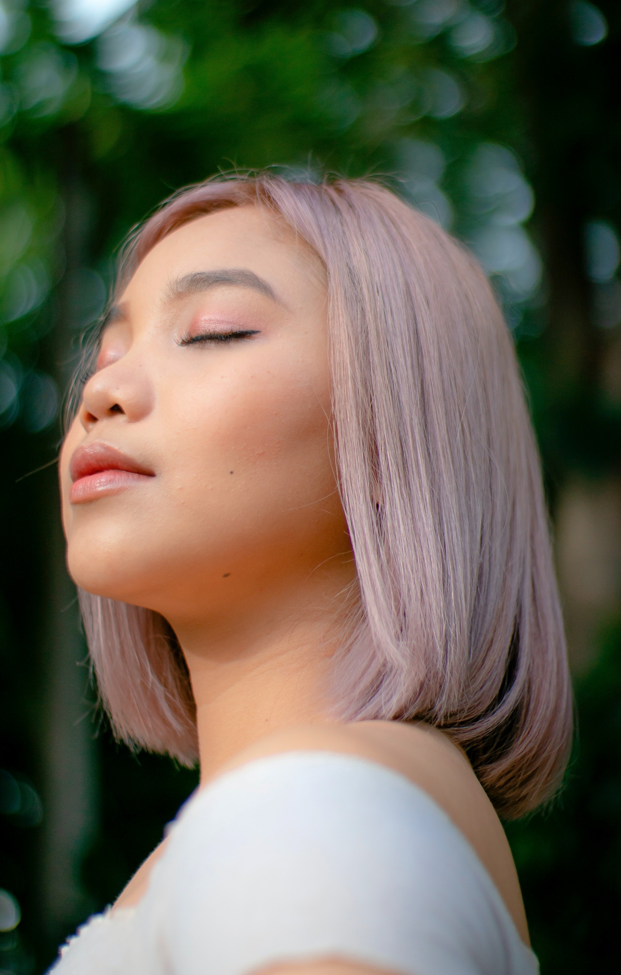 Asian woman with ash pink hair