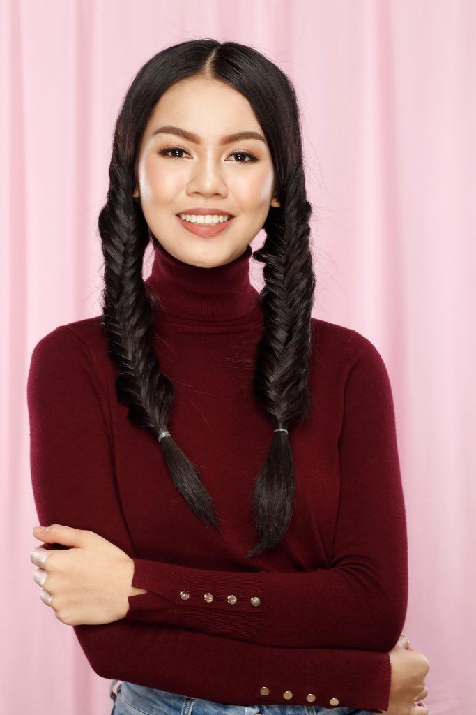 Asian woman with twin fishtail braids