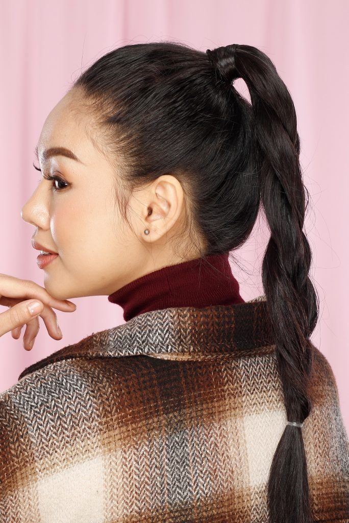 Asian woman with ponytail braid wearing a jacket