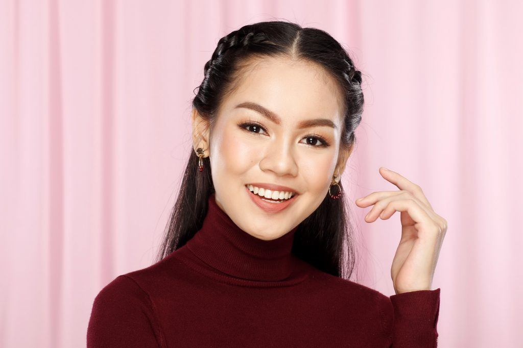 Asian woman with a shoelace braid hairstyle