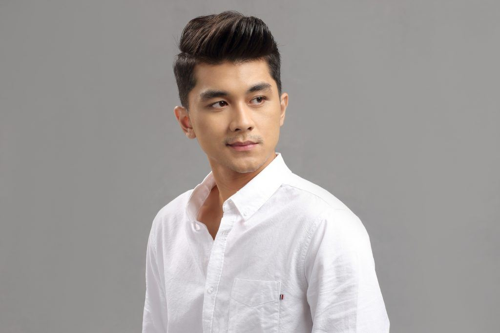 Asian man with a pompadour hairstyle