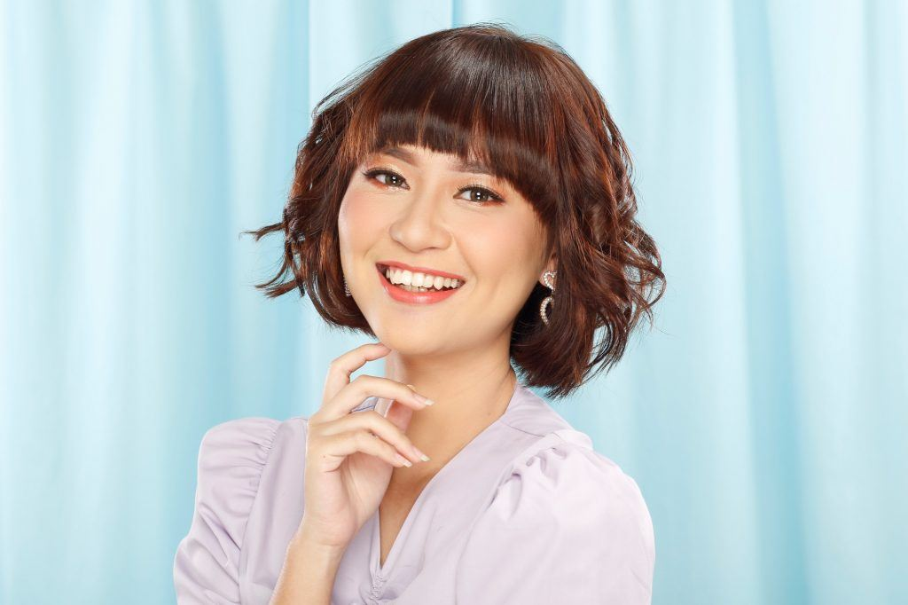 Asian woman with a textured French bob haircut