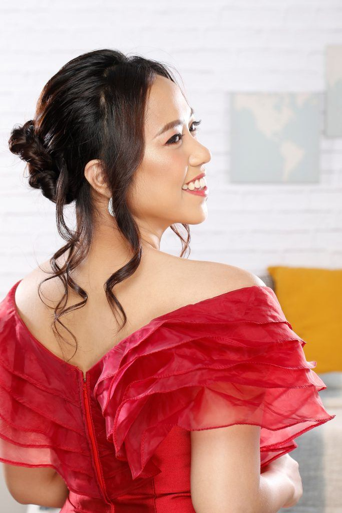 Asian woman with an updo and loose curls