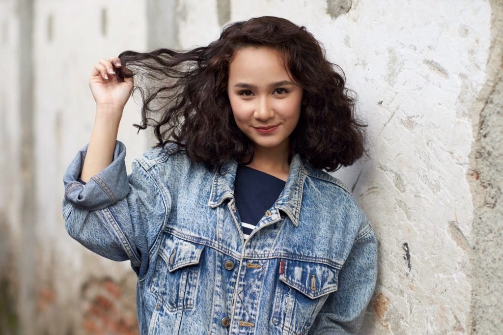 Asian woman with short curly hair