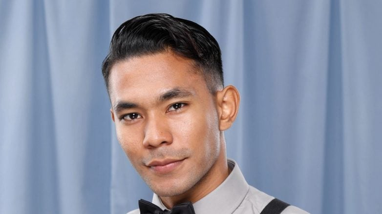 Asian man with a disconnected undercut wearing a bow tie