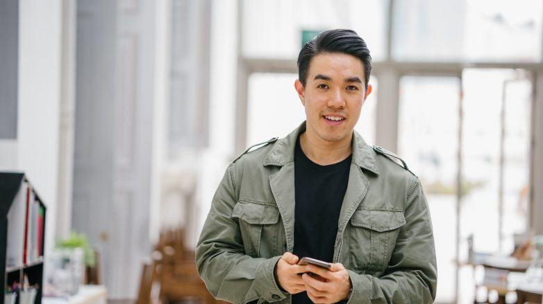 Best treatment for receding hair: Asian man with short hair wearing a jacket