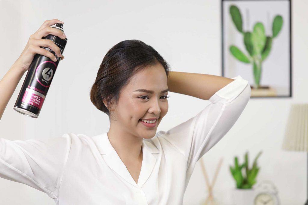 ผู้หญิงเอเชียผมยาวประบ่าสีดำ กำลังฉีดสเปรย์