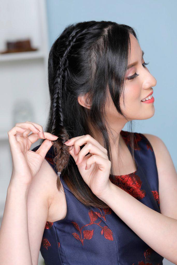 ผู้หญิงเอเชียผมยาวประบ่า ถักเปียก้างปลา
